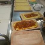 Preparazione in cucina della polenta in Agriturismo a L'Aquila